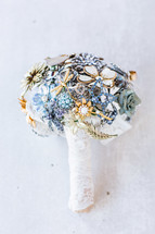 Bridal bouquet made from broaches non-floral white lace
