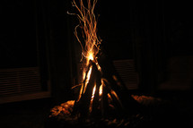 sparks and flames from a campfire