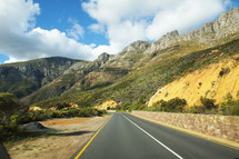 open road through the mountains