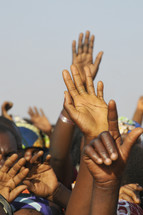 Nigerian hands raised - reaching out
