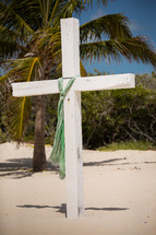 white cross on a beach