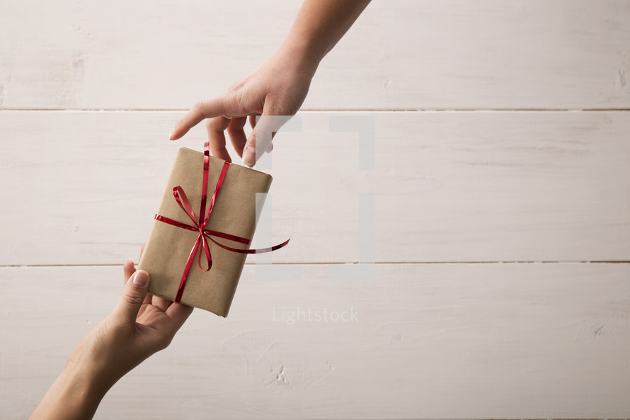 Gift giving from one person to another.
