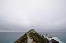 a lighthouse on a coastal cliff