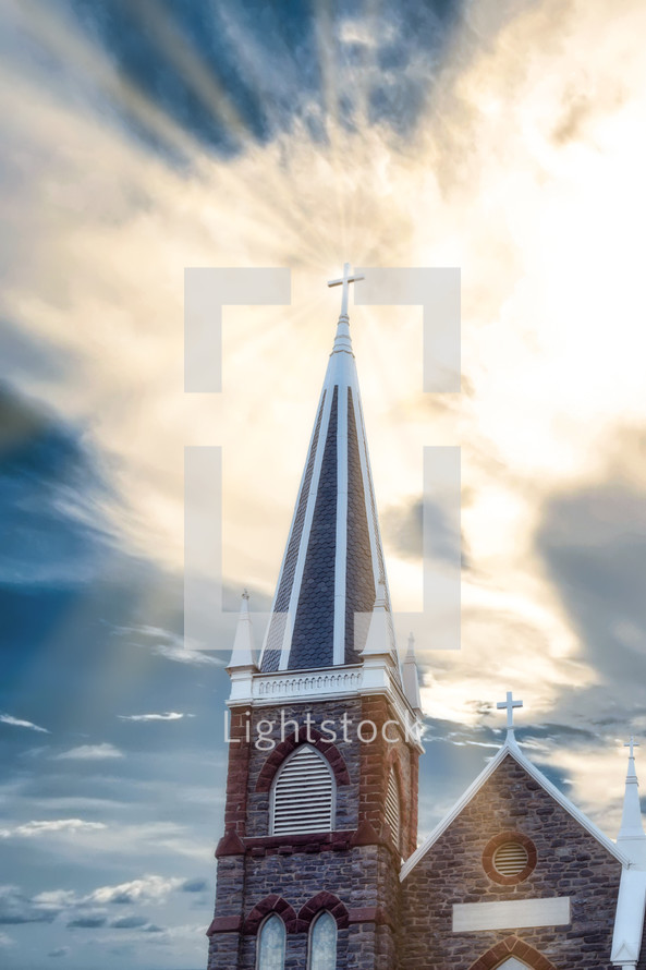 radiating sunbeams around a church steeple
