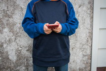a child playing a game app on a cellphone