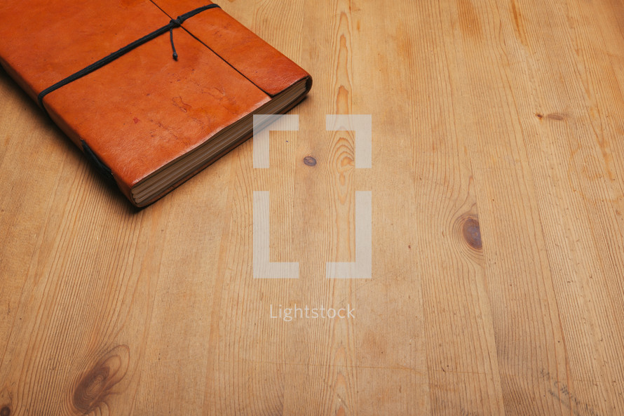 leather table on a journal