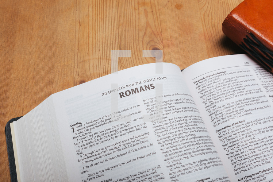 Romans on the pages of a Bible