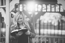 a woman reading in a gazebo