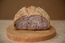 unusual craft bread with lilac-colored pulp on a brown background with copy space