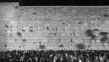 crowds praying in Jerusalem