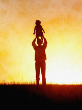 silhouette of a father lifting his child