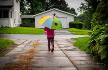 toddler with an umbrella