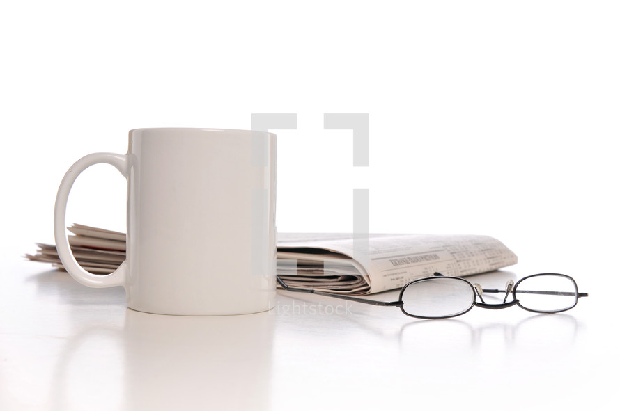 coffee mug, newspaper, and reading glasses