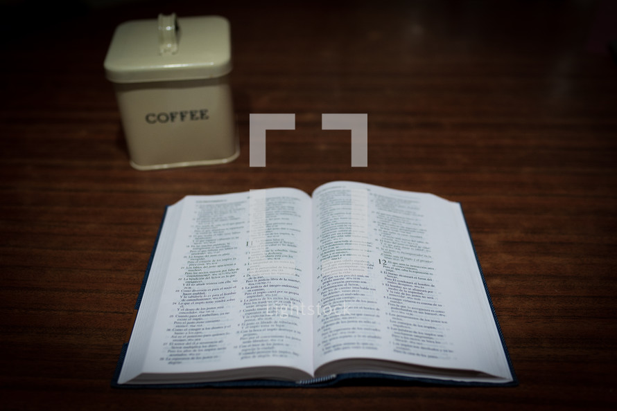 open Bible and coffee tin