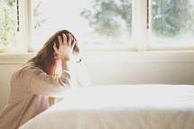 a woman upset in her bedroom