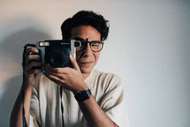 a man holding a camera taking a picture