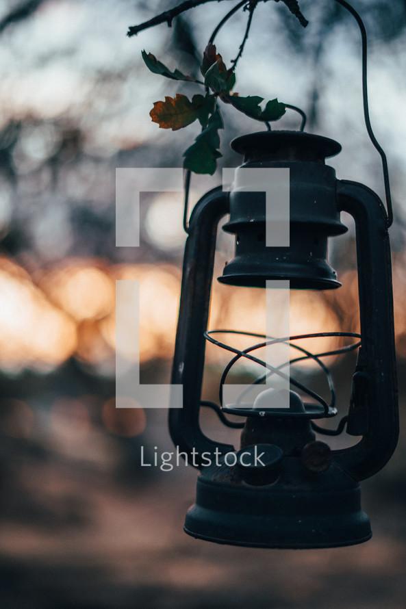 old rusty lantern at sunset
