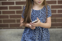a little girl listening to music