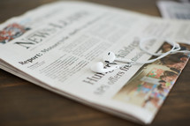 earbuds on a newspaper