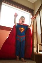A boy in a superman costume