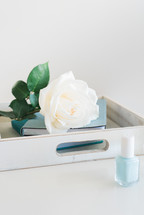 white rose and journal on a tray