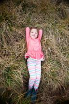 girl child lying in grass