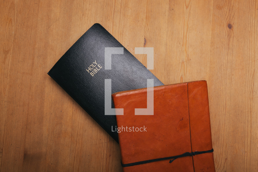 leather journal and Bible on a table