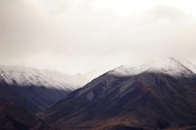 dusting of snow on mountain peaks