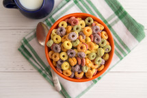 Bowl of Fruit Cereal on a Rustic Wooden Table