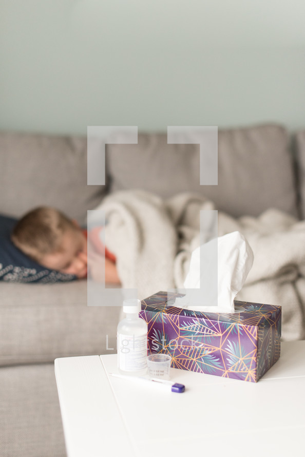 sick child sleeping on a couch