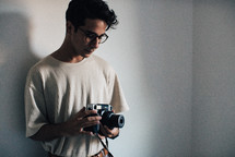 a young man standing holding a camera