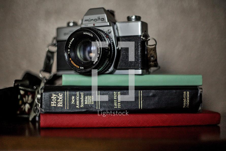 vintage camera on a Holy Bible