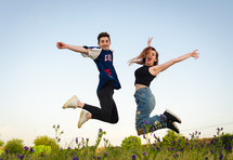 young couple jumping up