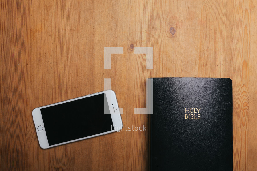 iphone and Bible on a table