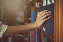 pulling a book off a shelf