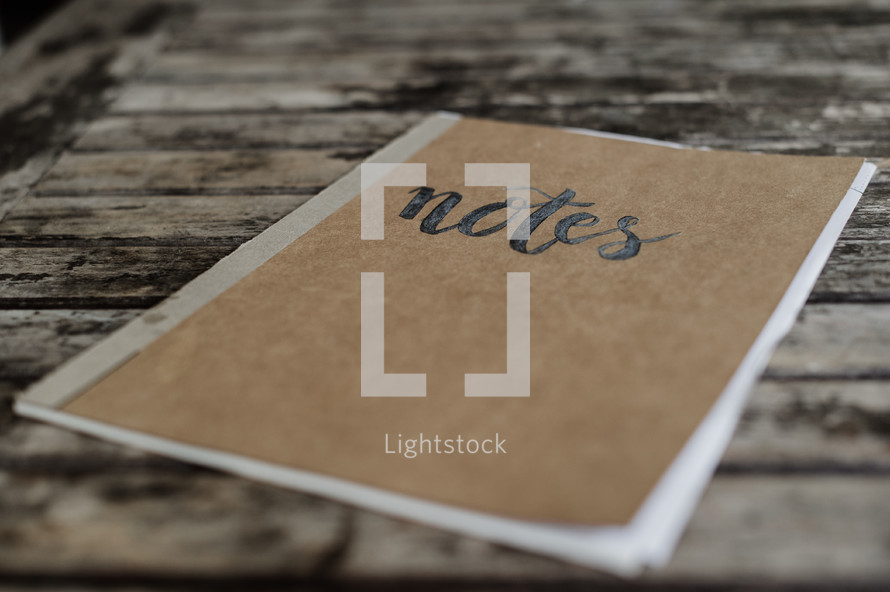 word notes on the cover of a notebook