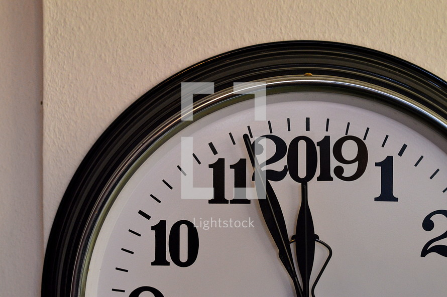A clock showing the last minutes before the new year 2019 starts.