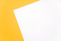 graph paper on yellow