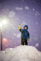 child in a snowsuit playing in the snow