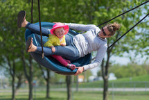 mother and daughter on a swing