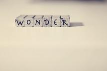 """Letter tiles spelling """"wonder."""""""