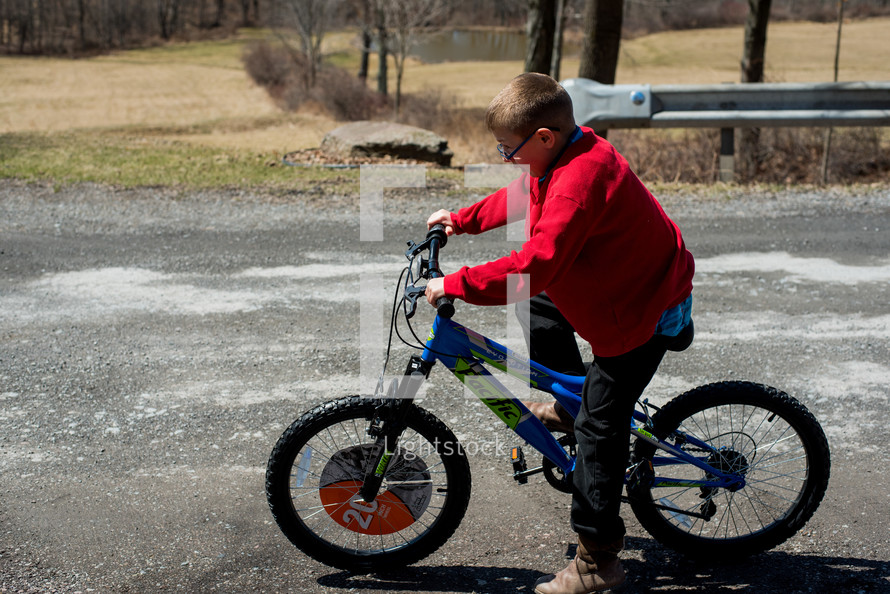 a boy riding a bicycle