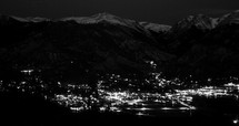 lights from a town in a valley at night