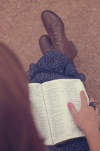 woman reading a Bible in her lap