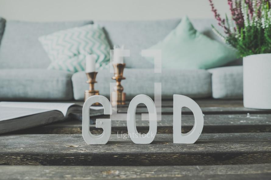 word God on a table