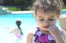 a toddler girl in a swim suit
