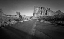 tall rock cliffs along a highway
