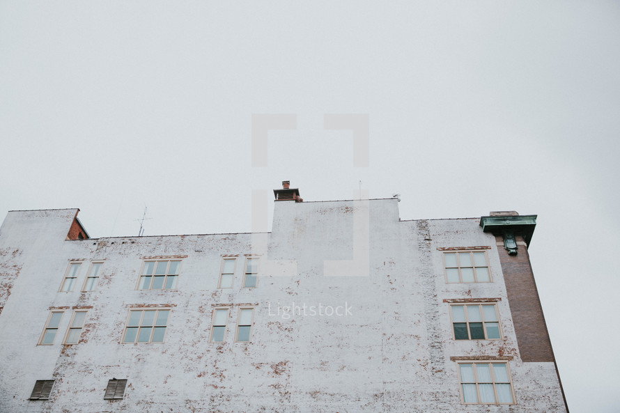 white washed brick building exterior walls