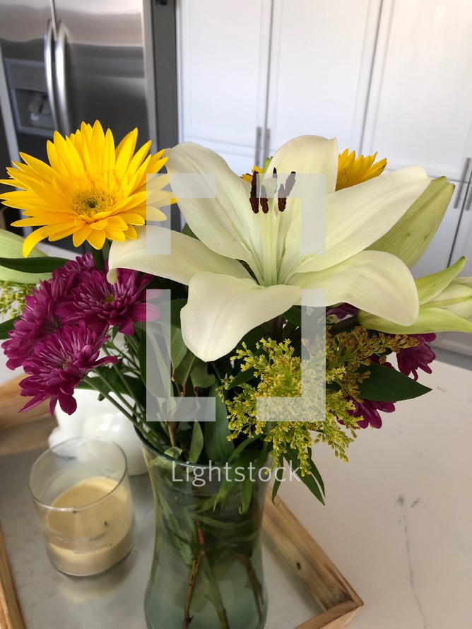 vase of flowers on a kitchen island