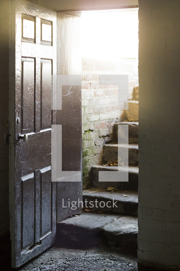 sunlight on steps to a cellar